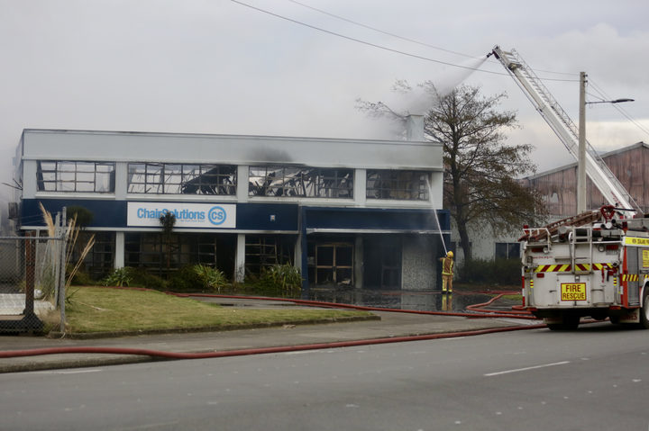 Firefighters tackling the blaze at Chair Solutions on Lower Hutt Park Road.