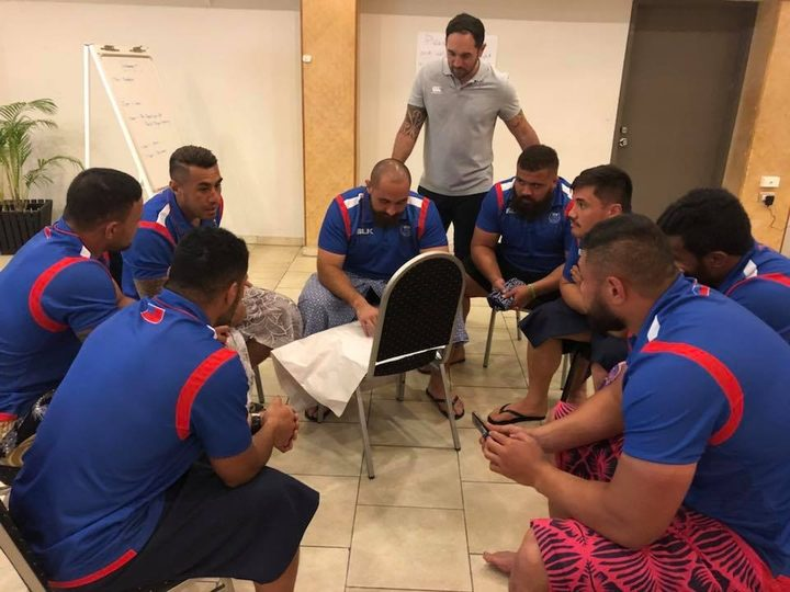 Pacific Rugby Players CEO Aayden Clarke (c) with members of the Manu Samoa team.