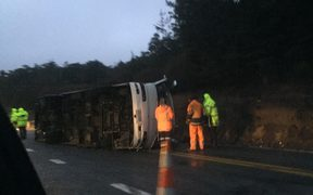 The bus is still on its side and a salvage team will work to remove it.