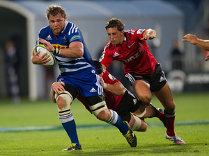 The Stormers' Daniel Vermeulen tackled by Matt Todd (back) and Tom Taylor of the Crusaders.