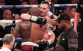 Joseph Parker congratulates Dillian Whyte on winning their heavyweight bout in London.