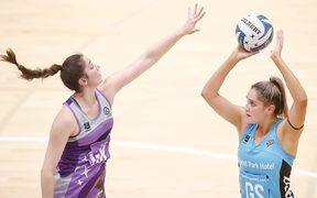 Steel shooter Te Huinga Reo Selby-Rickit shoots over Stars defender Kate Burley