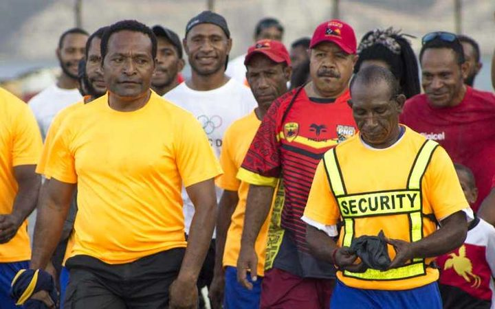 The governor of Papua New Guinea's National Capital District, Powes Parkop on his weekly Sunday walk and yoga sessions (in red cap third from right)