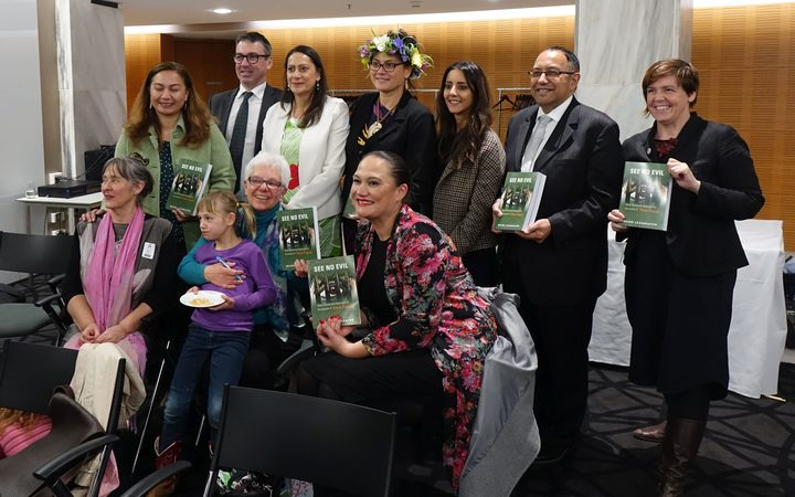 Author Maire Leadbeater (with niece on lap) surrounded by New Zealand MPs at the launch of her book 'See No Evil: New Zealand's betrayal of the people of West Papua'.