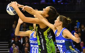 Central Pulse's Aliyah Dunn, centre, takes a pass with Northern Mystics captain Anna Harrison, right, and Phoenix Karaka, back.