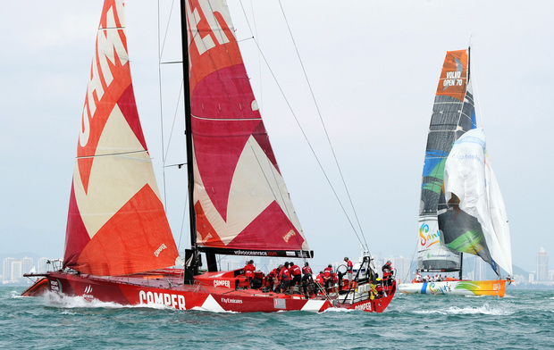The Camper Team New Zealand yacht (L) sails in an in-port-race during a Chinese stopover  last year.