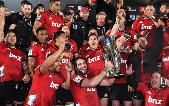 Crusaders players celebrate winning the Super Rugby Title in 2018. Crusaders v Lions, Super Rugby Final. AMI Stadium, Christchurch, New Zealand. Saturday 4 August 2018 © Copyright photo : Andrew Cornaga / www.photosport.nz