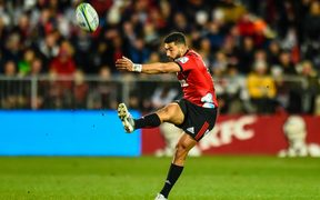 Richie Mo'unga of the Crusaders kicks the ball during the Super Rugby Final 2018.
