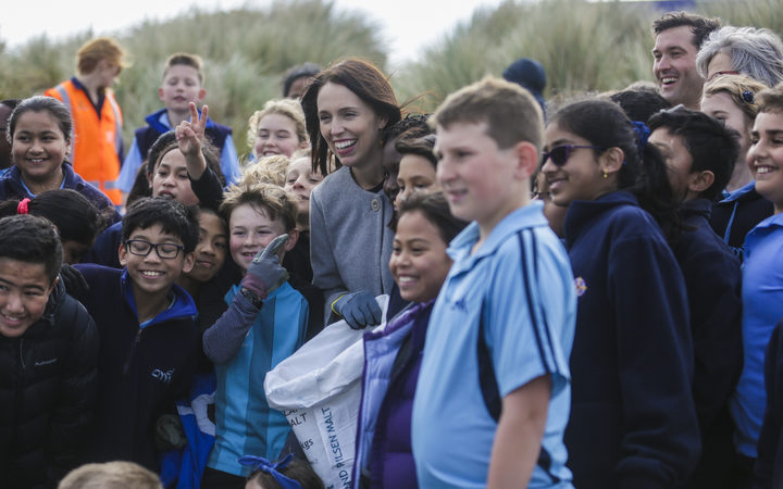 Prime Minister Jacinda Ardern and children from Petone College picking up rubbish on Wellington's Lyall Bay beach this morning.