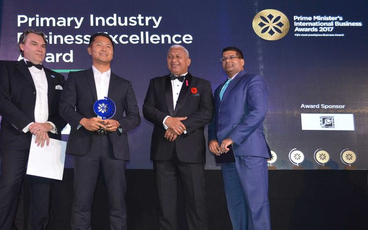 Fiji's prime minister Frank Bainimarama, second from right, is pictured at the awarding of a Prime Minister's Business Award to a member of Grace Road Group, the church's business arm, in 2017.