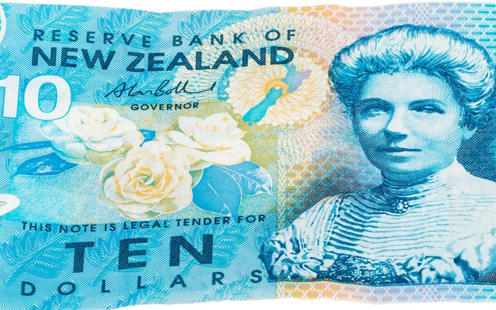 close up image of ten Dollar notes in New Zealand currency Dollar notes in New Zealand currency, front and back