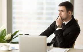 84439981 - thoughtful pensive businessman deep in thoughts looking away sitting near laptop at workplace, successful entrepreneur thinking over new ways to improve business, future perspectives, managing risks
