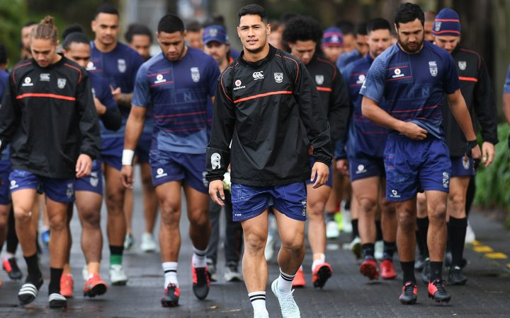 Warriors captain Roger Tuivasa-Sheck leads his team onto the training paddock.