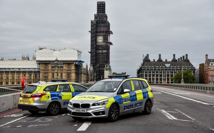 Police officers secure the roads around the Houses of Parliament as forensic teams continue their work around a vehicle after it crashed into security barriers, injuring a number of pedestrians, outside the Houses of Parliament on August 14, 2018 in London, England.