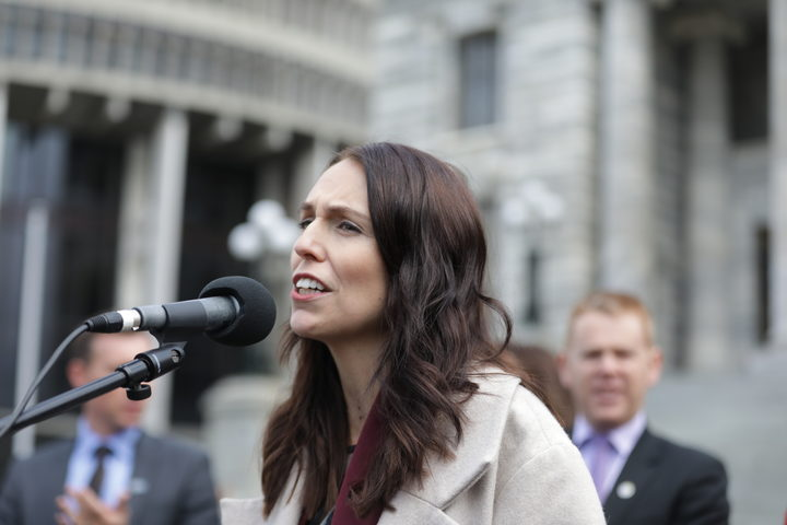 Prime Minister Jacinda Ardern speaks to striking teachers at Parliament grounds.
