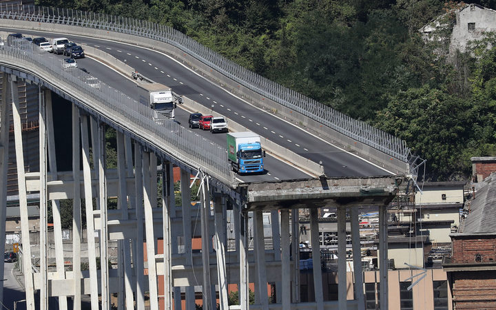 Vehicles on the Morandi motorway bridge the day after a section collapsed in the north-western Italian city of Genoa.