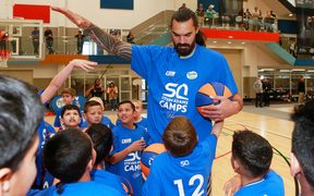 Steven Adams talks to young basketballers during one of his junior camps in Auckland.