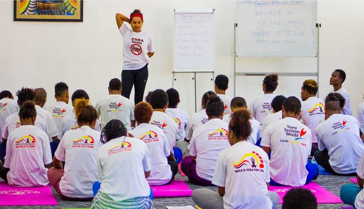 Fazilah Bazari, manager of the yoga component in the PNG National Capital District's Active City Development programme, teaching students.