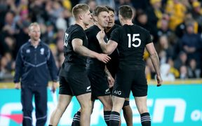 The All Blacks celebrate a try for Beauden Barrett.