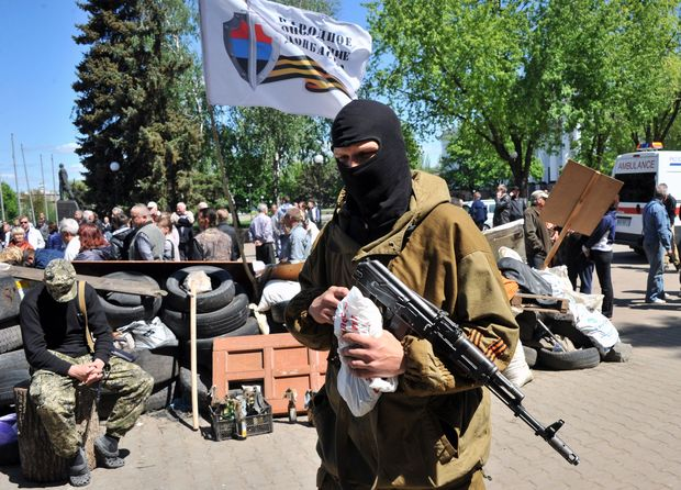 Pro-Russian militants guard a barricade outside the regional state building in Kramatorsk, eastern Ukraine.