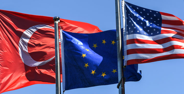 Turkish flag, European Union's flag and US flag float in the wind at the financial and business district Maslak in Istanbul.