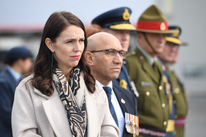 Prime Minister Jacinda Ardern and Defence Minister Ron Mark at the ramp ceremony at Auckland International Airport.