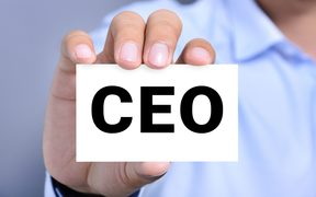 Card with CEO (Chief Executive Officer) held by a man's hand