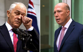 Australia's Prime Minister Malcolm Turnbull (L) and leadership challenger Peter Dutton
