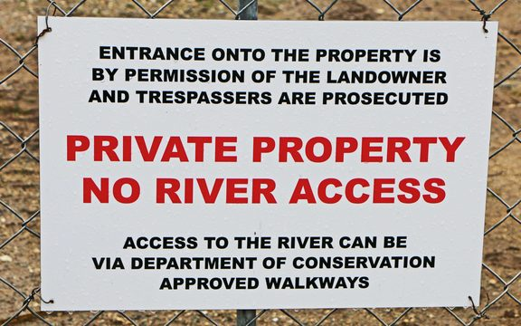 Sign saying Private Property entrance by permission, trespassers prosecuted.