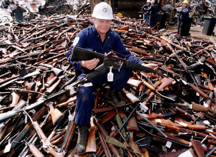 Norm Legg, a project supervisor with a local security firm, holds up an armalite rifle similar to the one used in the Port Arthur massacre and handed in for scrap on 8 September in Melbourne after Australia banned all automatic and semi-automatic rifles.