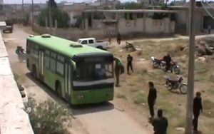 A bus takes activists out of Homs.