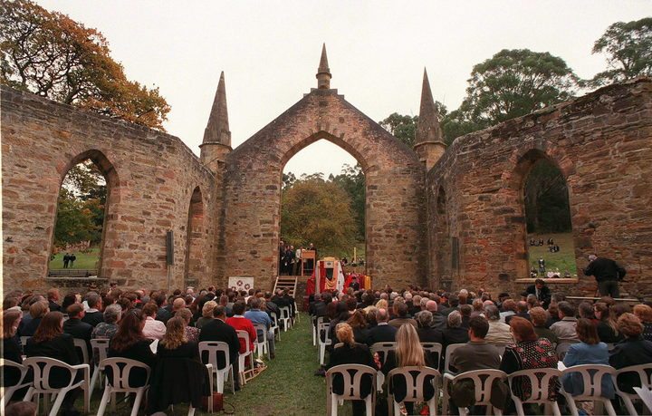 Relatives of victims killed or wounded by gunman Martin Bryant attend a memorial service in the ruins of Port Arthur 28 April to commemorate the first anniversary of the massacre.