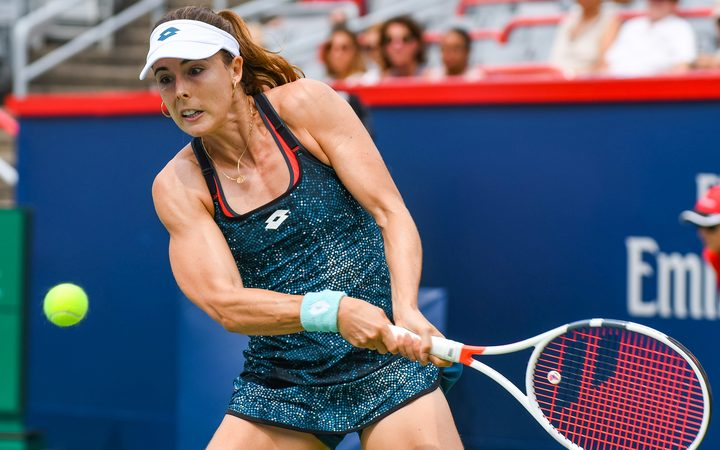 Alize Cornet penalized for taking off shirt at U.S. Open
