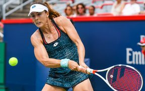 French tennis players Alize Cornet has been issued a code violation for taking off her top at the US Open.