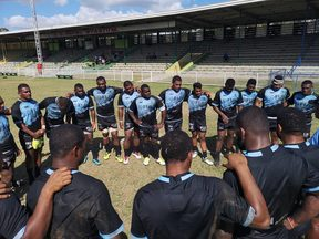 The Fijian Drua squad huddle together during training.