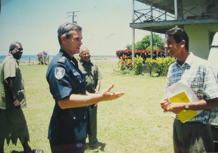 Andrew Hughes (left) in his role as Fiji Police Commissioner during a visit to St John's College in Cawaci in 2003 where he met Darren Koch (right) a fellow Australian who taught at the college.