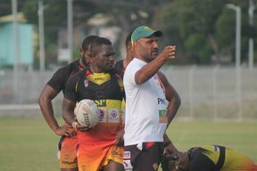 PNG Hunters coach Michael Marum gets his message across during training.
