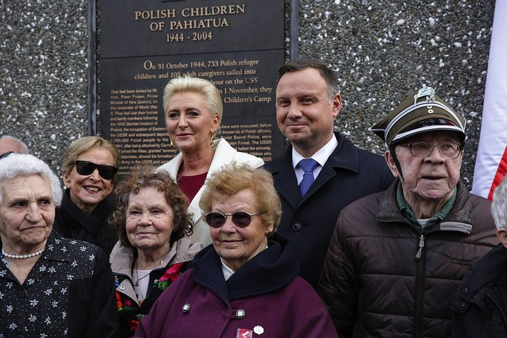 Andrjez Duda with his wife, Agata Kornhauser-Duda (at back) with members of the Polish Community in Wellington.