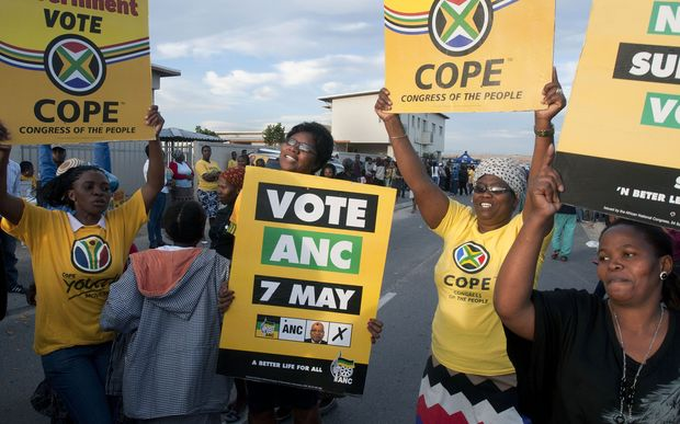 Supporters of rival ANC and Congress of the People (COPE) parties at a Cape Town polling station.