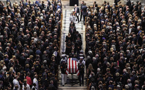 The casket of  the late US Senator John McCain, Republican of Arizona, is carried out after the National Memorial Service at the Washington National Cathedral in Washington, DC.