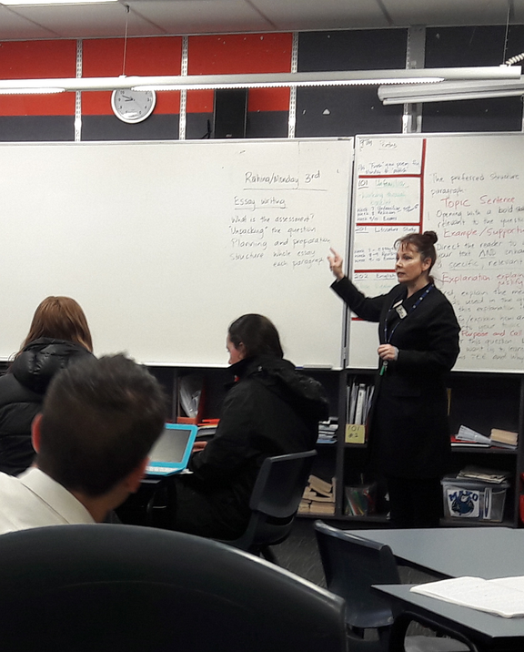 Tania Kelly Roxborogh in a classroom with students.