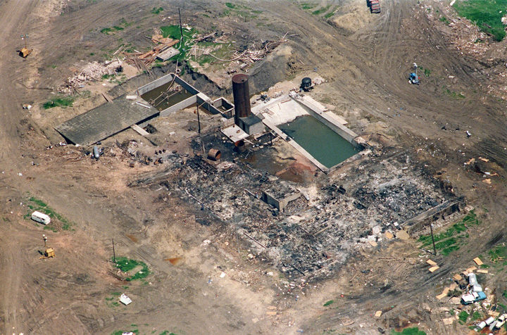 21 April 1993 in Waco, the only structure left standing after a fire destroyed The Branch Davidian cult compound 19 April. FBI and Texas Rangers check the area for victims of the blaze which ended a 51 day standoff between federal agents and the cult led by David Koresh.