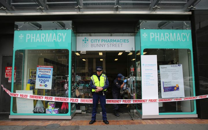 Police at the scene of a pharmacy robbery in central Wellington