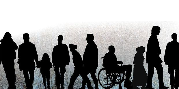 a crowd including someone in a wheelchair