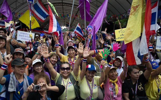 Anti-government protesters rally at  Government House in Bangkok.