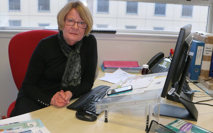 Hilary Graham-Smith of the Nurses Organisation, sitting at her desk