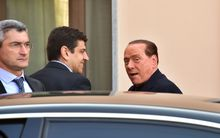Berlusconi (L) arrives at the hospice.