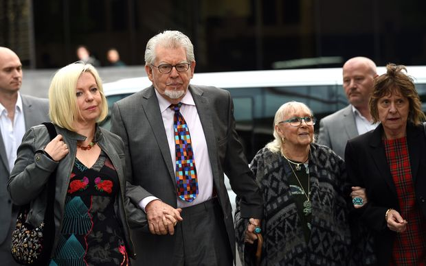Rolf Harris arrives at court with daughter Bindi (left) and wife Alwen Hughes (second right) on Friday.
