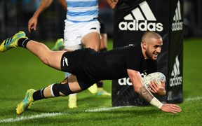All Black TJ Perenara scores a try during their Rugby Championship test match against Argentina