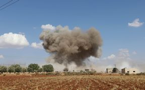 Smoke billows following Syrian government forces' bombardment around the village of al-Muntar